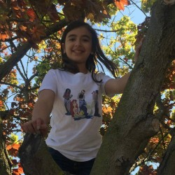 Anastasia climbing trees in her Chasing Waterfalls T-Shirt